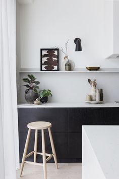 Clean and minimalist black and white kitchen with open shelving