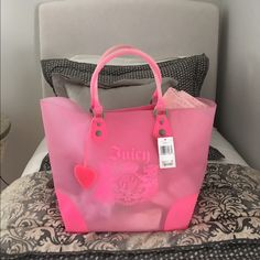NWT Juicy Couture Tote In great condition. Only a few small marks and one larger mark due to storage but they are very light in color. Bought at Bloomingdale's. Towel not included, just for staging purposes. I will throw in the bracelet for free as well!  Juicy Couture Bags