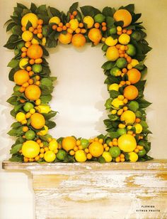Citrus wreath...satsumas and kumquats with magnolia leaves!