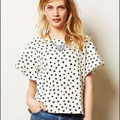 Anthropologie polka dotted flutter sleeve top This is black and white dotted top that can be dressed up or down. The material is a thick softly textured cotton. Keyhole button enclosure in the back. I labeled it medium although it is a small because it seems to run a little large. Anthropologie Tops Blouses