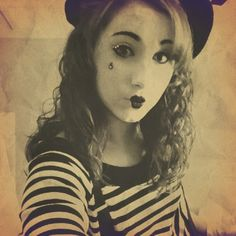 A mime. It is so cute and really easy. All you need is: black dress pants (rolled up), a black and white stripped shirt (tucked into the pants), black suspenders, and a beret. Then just use white face paint and paint your face. Add some Jewels and a black teardrop and blush. It looks amazing! :)