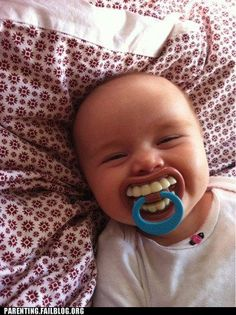 made me laugh everytime I looked at this pic...and yep, baby's shouldn't have teeth!  What a pacifyer!