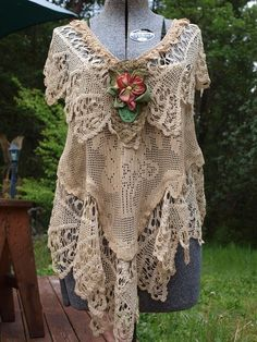 Beautiful dripping with lace Lucky Penny Wear top. Criss crosses in back and is as beautiful as the front. Made 2010. Sold on e-bay!