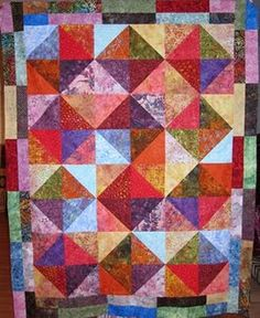 "Moda ""In A Jiffy"" pattern, layer cake from The Village Quilter and quilted by me."
