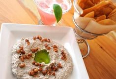 Black-eyed pea hummus appetizer served with house chips and the Babarita, Babalu Tacos and Tapas signature twist on the margarita.