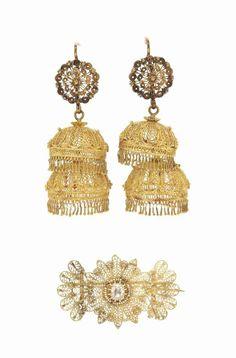 A Qajar diamond-set gold brooch and ensuite pair of earrings Iran, 19th century #christiesjewels