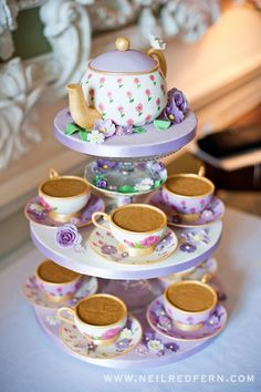 teapot cake.Could use cupcake tier and real tea cups for a great table centerpiece.