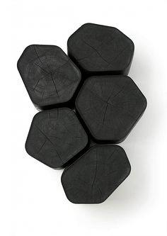 Black wooden table emulating volcanic basalt. in Shapes