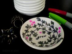 Small sauce dishes from Dollar Store that you decorate with sharpies to use as a ring/earring dish.