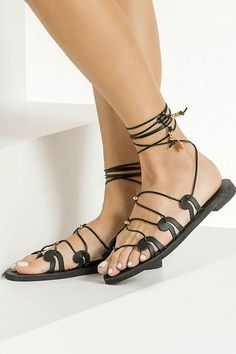 Our signature Danae gladiator sandals for Women are inspired from the ancient Greek wave motif as it also appears in our logo. This black pair is handcrafted from chemical-free vegetable-tanned leather with adjustable slim ties that can be worn high up or low at your ankles, detailed with gold plated beads and coins. Top quality flat sandals with anti-slip rubber sole for optimum comfort suitable for everyday wear from day to night. Available in 5 colors (black, tan, gold, silver and white).