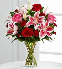 The FTD® More Than Love™ Vase arrangement is sweetly sophisticated and bursting with soft sentiments to sweep them off their feet. Pale pink roses, Stargazer Lilies, red mini carnations, pink snapdragons and lush greens are gorgeously arranged in a clear glass vase to create an arrangement that speaks of your limitless love and affection.  $69.99