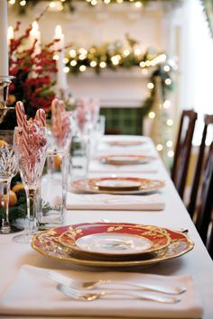 A formal table setting, including the homeowners' special Christmas china is ready for guests.