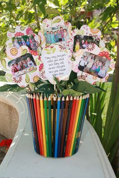 Thank you gift for my kids' preschool teacher with class pictures from each year.