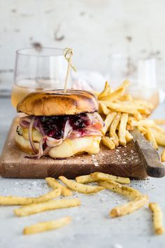 A juicy burger topped with smoked ham, blueberry jam and melted Arla Muenster Cheese.