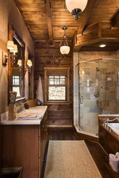 Gorgeous cabin bathroom with large glass shower.