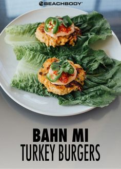 This Lettuce-Wrapped Bahn Mi Turkey Burger is a flavorful spin on the traditional Vietnamese Bahn Mi sandwich. It swaps out the bread for lettuce leaves, cutting down on carbs and adding a nice crunchy texture. // healthy recipes // lunches // dinners //