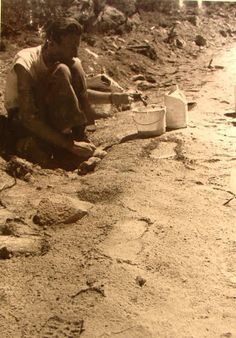 John Green near Bluff Creek, CA... looking at large footprints in 1967. Bigfoot was here!