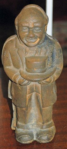 "ANTIQUE CAST IRON BANK-FEATURES A BLACK MAN STANDING WEARING A TUXEDO HOLDING A TOP HAT-THERE IS A SLOT ON THE BACK FOR COINS-BANK CAN BE OPENED BY REMOVING SCREW-IN EXTREMELY NICE CONDITION,NO DAMAGE,WITH SOME MINOR SURFACE RUST,THAT COULD BE EASILY REMOVED-APPEARS TO HAVE BEEN NEVER PAINTED-MEASURES APPROX. 9"" TALL BY 4""ACROSS-VERY HEAVY CAST IRON WEIGHS 5.3 LBS NOT PACKED! MOST LIKELY FROM CIRCA: EARLY 1900 S--FOR SALE AT LABONNEVINVANTE.COM"