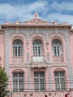 Pink and gray decorative facade with balcony...anyone know where this is located?