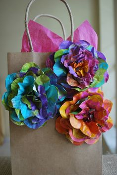 Newspaper flowers. We could make these flowers in Kristen's colors & just do one per gift bag.