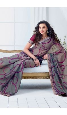 Grace yourself by draping in this Grey #chiffon #brasso printed #casual wear #saree with trendy and #elegant print on it. The saree is an ideal choice of attire for casual events and comes attached with matching blouse piece that can be custom made for upto bust size of 42 inches.