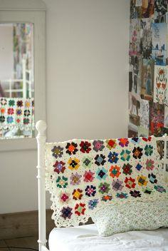 "crochet granny square blanket (I spy ""The Way We Were"" on the wall). Crochet Home, Love Crochet, Learn To Crochet, Beautiful Crochet, Knit Crochet, Crochet Granny, Plaid Crochet, Blanket Crochet, Crochet Afghans"