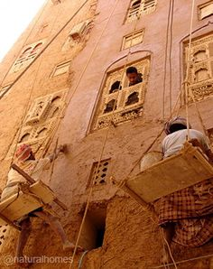 These are the 500 year old, eight storey high, adobe homes of Shibam in Yemen. The city is a UNESCO world heritage site. The adobe walls get thinner towards the top of the building to reduce the pressure on the lower walls. More, including video, at www.naturalhomes.org/shibam.htm
