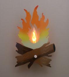 Lenny LOVES night lights...he also loves ripping them off the socket.  Love this idea - Campfire night light