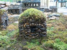 this guy makes miniature stone houses and they're amazing.  check out his blog.