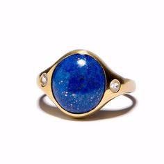 Our new favorite ring. Available in 14k yellow gold plate over sterling silver with lapis and white topaz, or 14k rose gold plate over sterling silver with bronze calcite and white topaz