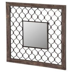 "Add an eye-catching focal point to your entryway or living room decor with this chic wall mirror, showcasing a distressed wood frame and an open metalwork overlay.   Product: Wall mirrorConstruction Material: Metal, wood and mirrored glassColor: Brown frameFeatures:  Lattice patternDistressed finishOpenwork metal Dimensions: 32"" H x 32"" W x 2"" D"