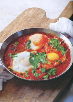 Tomatoes, Swiss chard and eggs delight in this hearty holiday breakfast recipe from HGTV.