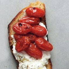 Sweet roasted tomatoes and mild, creamy ricotta are the perfect combo atop crusty roasted bread. Recipe: Roasted Tomato and Ricotta Crostini   - Delish.com