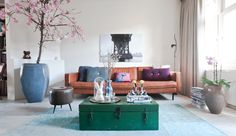 Eclectic living room - I love the mix of this cognac leather sofa and the green trunk as coffee table