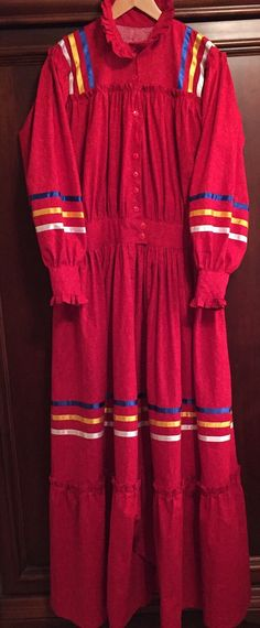 Made to order traditional Cherokee style Tear Dress - 100% cotton calico, poly ribbon. This Tear dress is made as one piece with fitted waistband. You can choose your size, the color fabric and 3 colors of ribbons. One piece Tear Dress $235.00. With 1 pocket $250.00. All Regalia is custom made to order.