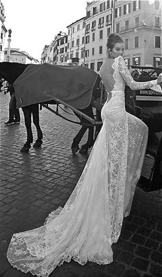 such beautiful open back and long train on this bride.