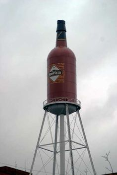 """The """"OLD FORESTER"""" water tower at Louisville, Kentucky, has been called the """"World's Largest Bourbon Bottle Replica."""""""
