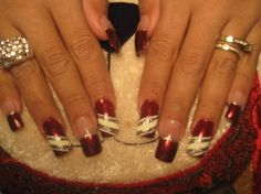 Red manicure with white and gray decorations