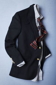 Navy sport coat, white shirt with light blue dress stripes, tie with red, yellow, & navy stripes