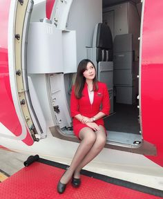 """Air Asia stewardess: """"Personally I have never had to restrain anyone, but. I know some of my most petite female colleagues have cuffed aggressive male passengers. It's regrettably sometimes part of the job. Airline Attendant, Flight Attendant, Beautiful Asian Women, Beautiful Legs, Asian Woman, Asian Girl, Flight Girls, Tight Pencil Skirt, Mini Skirts"""