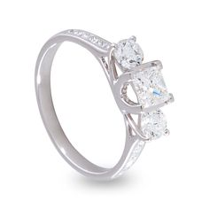 Beautiful Platinum Princess Cut & Round Brilliant Diamond Tulip Trilogy Engagement Ring.   Stock Number: 01-02-007