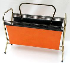 Store your magazines with retro style with this incredible orange vinyl, metal mesh and brass magazine rack.  Measuring 43.5cm long, 39cm high