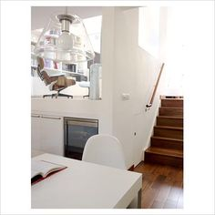 Split level kitchen- homework area at top of stairs, day bed/reading nook with lots of pillows in front of window wall