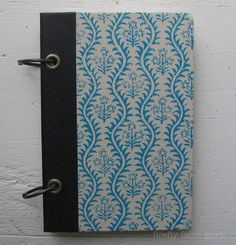 No.2 Vintage Book Cover Journal   1969 vintage, blue/cream patterned covers 90 sheetsblank, white paper, 70 lb. wt.   two binder rings and holes reinforced with metal eyelets secure...