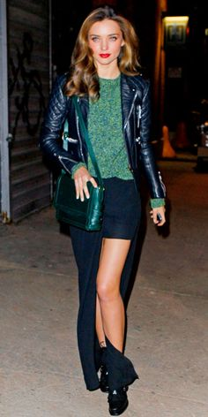 Miranda Kerr in a green Acne knit, leather Christian Louboutin bag and Tabitha Simmons lace-up booties