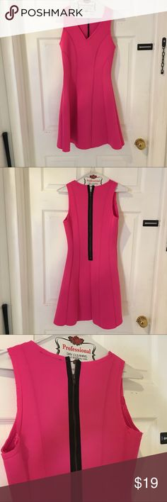 Scuba HOT pink mini dress Scuba fabric and figure fitting! Sleeveless. A must have for your spring summer wardrobe! Black and gold tone zipper! Flare skirt! Perfect for traveling as this is wrinkle free! Monteau Dresses Mini