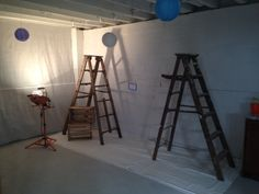 painting drying area using two wooden ladders and string.