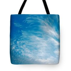 Backgrounds Tote Bag featuring the photograph Strong Winds Forming Cirrus Clouds With A Deep Blue Sky. by Jan Brons. Strong winds forming cirrus clouds with a deep blue sky.     Cirrus clouds are mostly a sign of changing weather, often more stormier weather. As a sailor I notice that a day later the winds are much stronger.   Take a look at the cirrus wikipedia page for more information on the interesting subject of meteorology.