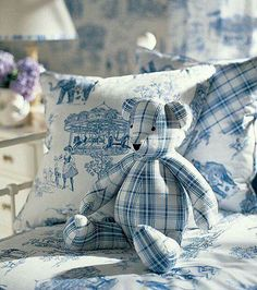 blue and white teddy and cushions