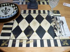 Handpainted Placemats Harlequin Fleur De Lis Design Floorcloth style Black Gold or Your choice of colors. $100.00, via Etsy.